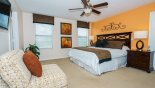 Master bedroom #2 with wall mounted LCD cable TV - www.iwantavilla.com is the best in Orlando vacation Villa rentals