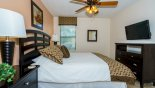 Bedroom #5 with wall mounted LCD cable TV with this Orlando Villa for rent direct from owner