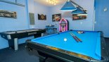 Games room with pool table, air hockey soft-tip dartboard and jukebox from Bimini 5 Villa for rent in Orlando