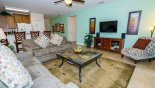 Family room with wall-mounted LCD cable TV & sound system - www.iwantavilla.com is the best in Orlando vacation Villa rentals