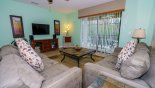 Spacious rental Cypress Pointe Villa in Orlando complete with stunning Family room with comfortable sofas