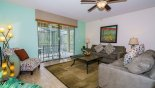 Family room with views and direct access onto pool deck from Cypress Pointe rental Villa direct from owner