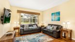 Living room with views onto pool deck from Highlands Reserve rental Villa direct from owner