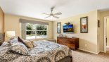 Villa rentals near Disney direct with owner, check out the Master Bedroom #1 with wall mounted 40