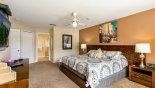 Spacious rental Highlands Reserve Villa in Orlando complete with stunning Master bedroom #1 viewed towards ensuite bathroom