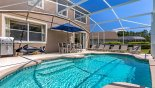 View of pool showing stainless steel BBQ provided free of charge from Monticello 5 Villa for rent in Orlando