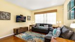 Spacious rental Highlands Reserve Villa in Orlando complete with stunning Living room with wall mounted 50
