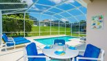 Covered lanai with patio table & 4 chairs - www.iwantavilla.com is the best in Orlando vacation Villa rentals