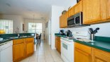 Fully fitted kitchen viewed towards dining area with this Orlando Villa for rent direct from owner