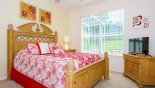 Villa rentals in Orlando, check out the Master bedroom #1 with solid pine queen bed, LCD cable TV & views onto pool deck