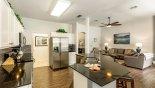 Kitchen with granite breakfast bar & 2 bar stools - www.iwantavilla.com is the best in Orlando vacation Villa rentals