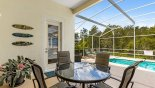 Villa rentals in Orlando, check out the View of patio table with 4 chairs from very private covered lanai