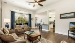 Family room with views and direct access onto pool deck with this Orlando Villa for rent direct from owner