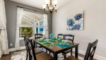 Dining area with dining table & seating for 6 persons - views onto pool deck from Jasmine 3 Villa for rent in Orlando