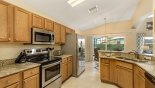Villa rentals in Orlando, check out the Fully fitted kitchen with quality stainless steel appliances and granite counter tops
