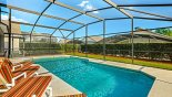South facing pool with privacy hedges to left & rear from St Vincent Sound 5 Villa for rent in Orlando