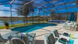 Pool deck with 4 sun loungers to help you soak up the rays with this Orlando Villa for rent direct from owner