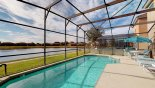 Pool deck gets the sun all day - frosted screens either side offer increased privacy with this Orlando Villa for rent direct from owner