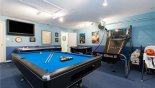 Spacious rental Emerald Island Resort Villa in Orlando complete with stunning Games room complete with large LCD cable TV, pool table, air hockey, foosball table & basketball game - an activity for all