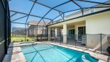 Spacious rental Solara Resort Villa in Orlando complete with stunning Pool viewed towards covered lanai providing welcome shade when required