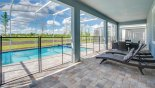 Pool deck showing pool safety fence erected with this Orlando Villa for rent direct from owner