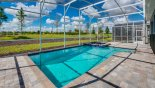 Spacious rental Champions Gate Villa in Orlando complete with stunning Sunny west-facing pool & spa with open views