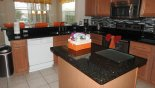 Spacious rental Highlands Reserve Villa in Orlando complete with stunning Fully fitted kitchen with granite counter tops
