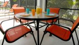 Villa rentals in Orlando, check out the Shaded lanai with patio table & chairs