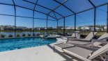 Pool deck with 6 sun loungers (2 out of view) from Mendocino 1 Villa for rent in Orlando