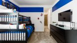 Spacious rental Reunion Resort Villa in Orlando complete with stunning Ensuite bedroom #5 with wall mounted LCD cable TV