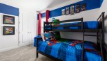 Ensuite bedroom #5 with bunk beds (twin over full-size) & Marvel theming from Reunion Resort rental Villa direct from owner
