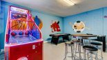 Games room showing basketball game plus high table with 4 bar stools from Crestview 2 Villa for rent in Orlando