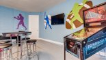 Villa rentals near Disney direct with owner, check out the Games room showing Terminator 3 pinball machine & wall mounted LCD cable TV
