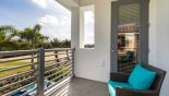 Balcony off master bedroom #1 with views over pool deck & golf course - www.iwantavilla.com is the best in Orlando vacation Villa rentals