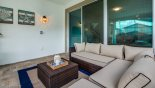 Covered lanai with comfortable ratan seating area - www.iwantavilla.com is the best in Orlando vacation Villa rentals