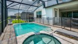 Villa rentals in Orlando, check out the Pool deck viewed towards covered lanai showing pool safety fence erected