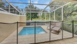 Pool deck showing pool safety fence erected - www.iwantavilla.com is the best in Orlando vacation Townhouse rentals