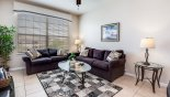 Living room with comfortable seating from Santa Anna 1 Condo for rent in Orlando