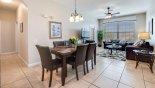 Living room and dining area with tiled floors in main living space from Windsor Palms rental Condo direct from owner