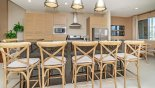 Breakfast bar with seating for 6 persons on bar stools from Magic Village Resort rental Townhouse direct from owner