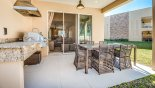 Covered lanai with patio table & 5 chairs plus box seat - www.iwantavilla.com is the best in Orlando vacation Townhouse rentals