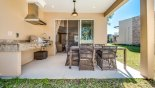 Spacious rental Magic Village Resort Townhouse in Orlando complete with stunning Covered lanai with outdoor kitchen incorporating a built-in gas BBQ