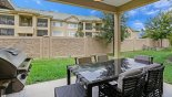 Covered lanai with patio table & 5 chairs & additional box seat - www.iwantavilla.com is the best in Orlando vacation Townhouse rentals