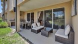 Covered lanai showing sofa set from Magic Village Resort rental Townhouse direct from owner