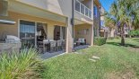 Orlando Townhouse for rent direct from owner, check out the Covered lanai with outdoor kitchen, patio table and separate seating area