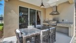 Covered lanai with outdoor kitchen incorporating a built-in gas BBQ - www.iwantavilla.com is your first choice of Townhouse rentals in Orlando direct with owner