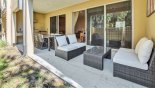 Covered lanai with comfortable ratan seating area - www.iwantavilla.com is the best in Orlando vacation Townhouse rentals
