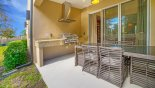 Spacious rental Magic Village Resort Townhouse in Orlando complete with stunning Covered lanai with outdoor kitchen incorporating a built-in gas BBQ & inset sink