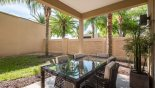 Townhouse rentals in Orlando, check out the Covered lanai with patio table & 5 chairs & additional box seat