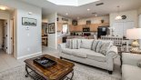 Spacious rental Emerald Island Resort Villa in Orlando complete with stunning Family room viewed towards kitchen